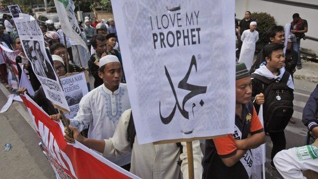 Indonesian Muslim men display posters during a protest against the caricature of Prophet Muhammad published in French satirical weekly Charlie Hebdo, outside the local office of French Alliance in Medan, North Sumatra, Indonesia, 23 January 2015.