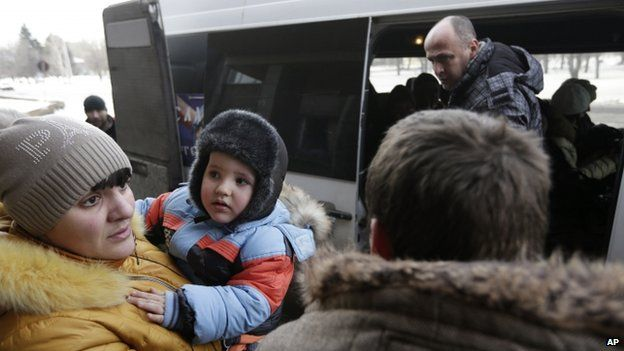 Debaltseve civilians board a bus to leave the town. Photo: 31 January 2015