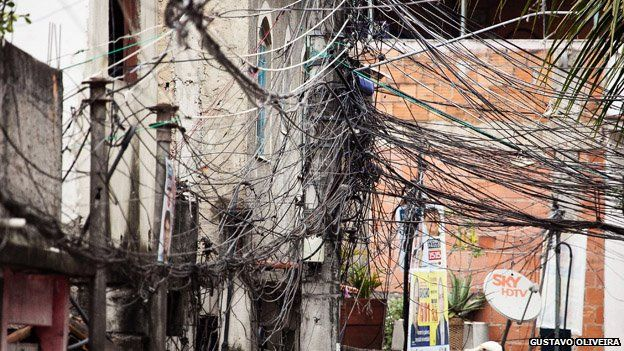 Chaotically strung cables can be seen in Vila Uniao in January 2015