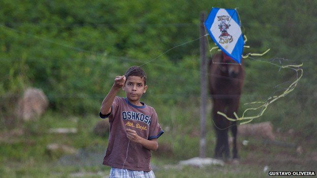 A child plays with a kite in Vila Uniao in January 2015