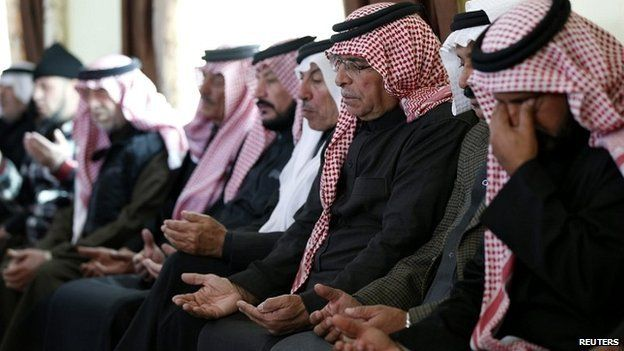 Saif al-Kasasbeh, the father of the Jordanian pilot, prays at the family's clan headquarters in the city of Karak - 4 February 2015