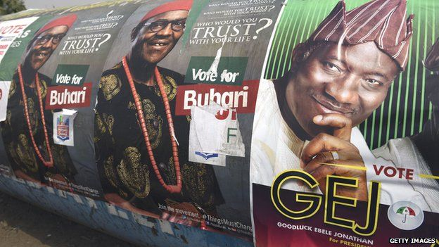 A poster of Nigerian President Goodluck Jonathan (R) and presidential candidate of the ruling People's Democratic Party (PDP) is displayed side by side with leading opposition All Progressive Congress presidential candidate Mohammadu Buhari along the highway in Lagos