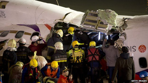 Rescuers finally gain entry to the previously submerged area of the plane