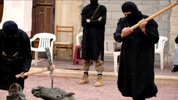 An image posted online by militants who claim to be part of the Islamic State group showing them destroying statues in Derna - 1 February 2015