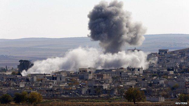 An explosion following an air strike is seen in western Kobani neighbourhood in November 2014
