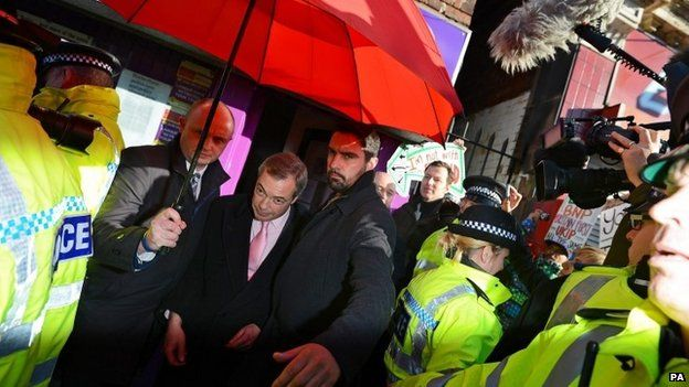 Nigel Farage leaving the building with a police escort