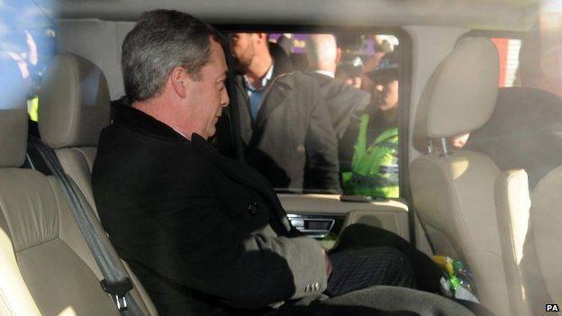 Nigel Farage sitting in his car