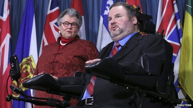 Conservative Member of Parliament Steven Fletcher (R) speaks during a news conference with Senator Nancy Ruth on Parliament Hill in Ottawa 2 December 2014