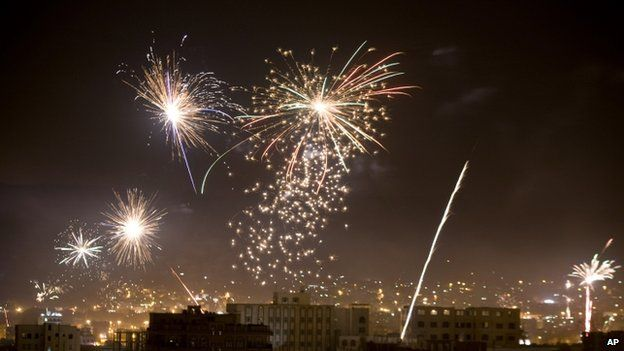 Houthi Shiite rebels and their supporters release fireworks after Shiite rebels announced that they have taken over the country and dissolved parliament in Sanaa,
