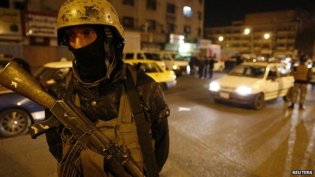 A member of Iraq's security forces stands guard at Tahrir Square in Baghdad February 8, 2015
