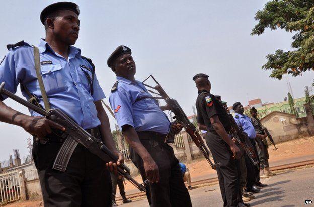 Nigerian police patrol the Nigerian capital, Abuja, 7 February