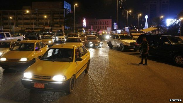 Vehicles are seen on a street in Baghdad February 8, 2015