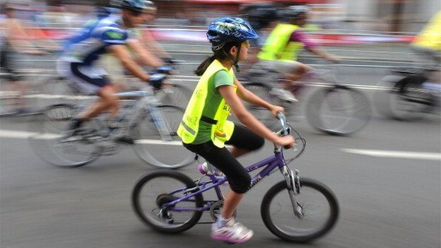 Girl takes part in Prudential RideLondon on August 3, 2013 in London