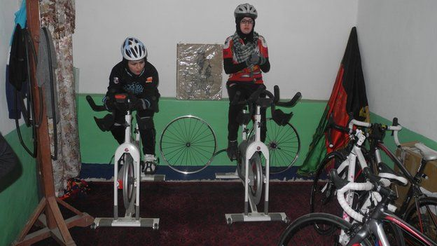 Women training on bicycles indoors in Kabul in Afghanistan, 2015.