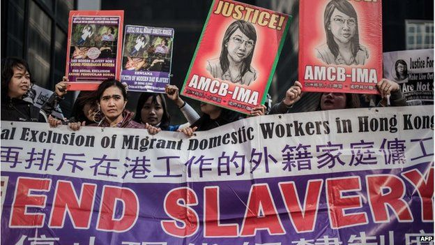 A group of protesters gather outside the courthouse in support of Indonesian former maid Erwiana Sulistyaningsih in Hong Kong on 10 February 2015.