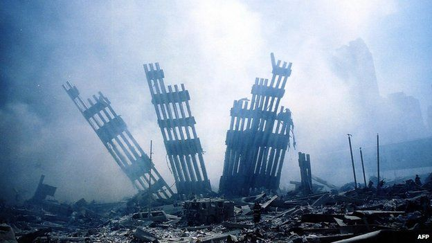 The rubble (ruins, debris, three pronged steel structures) of the World Trade Center smoulders following a terrorist attack on 11th September 2001