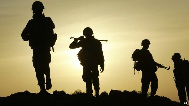 Soldiers walk back to an army camp as the sun sets near Thoppigala, about 240km north-east of Colombo, Sri Lanka, Monday, July 9, 2007