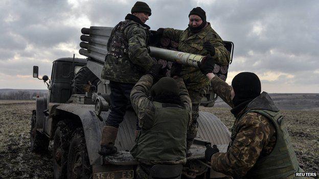 Ukrainian servicemen load Grad rockets near Debaltseve, 8 Feb 15