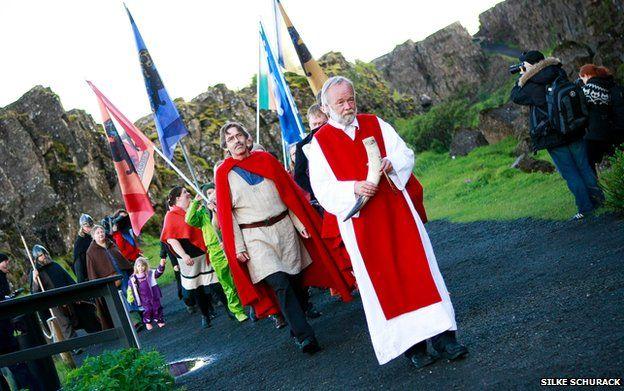 High priest of the Asatru Association, Hilmar Orn Hilmarsson, leads a procession of fellow members of the Asatru Association at the Thingvellir National Park near Reykjavik in June 2012.