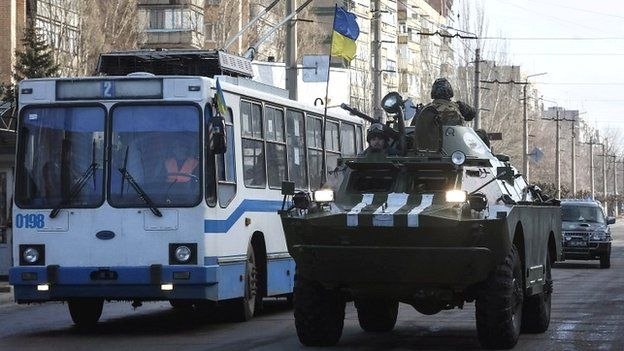 Members of the Ukrainian armed forces ride on an armoured personnel carrier in Kramatorsk - 11 February 2015