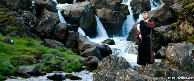 A member of the Asatru Association stands by a river at the Pingvellir National Park near Reykjavik in 2012
