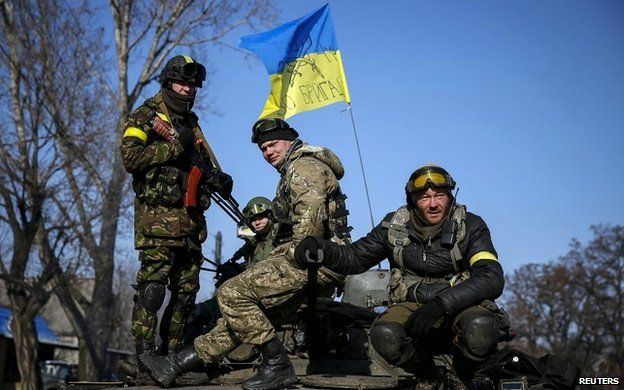 Members of the Ukrainian army ride on an armoured personnel carrier near Debaltseve - 12 February 2015