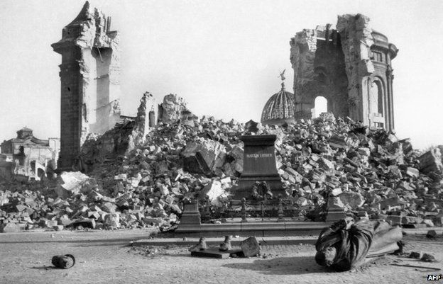 Dresden's Frauenkirche (Church of Our Lady) and the destroyed Martin-Luther-Memorial in February 1945