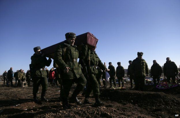 Rebel fighters carry a coffin at Mospino, near Donetsk, 12 February