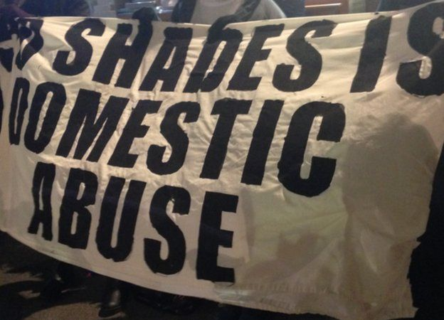 banner reading 50 shades is domestic abuse