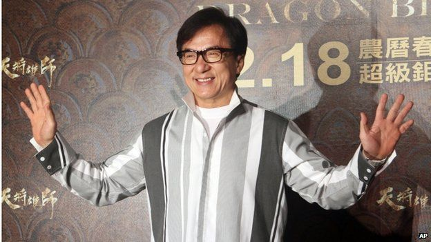 """Hong Kong actor Jackie Chan poses for photo call during an event to promote his new movie """"Dragon Blade"""" in Taipei, Taiwan, Thursday, 12 February 2015"""