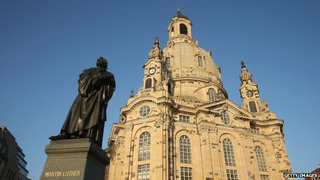 A statue of Martin Luther stands outside the Church of Our Lady, which was obliterated by Allied bombing raids 13-15 February 1945 and rebuilt in 2005