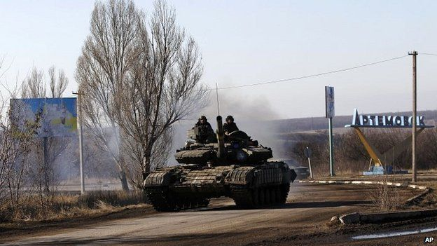Ukrainian government troops ride a tank towards the besieged town of Debaltseve in eastern Ukraine - 13 February 2015