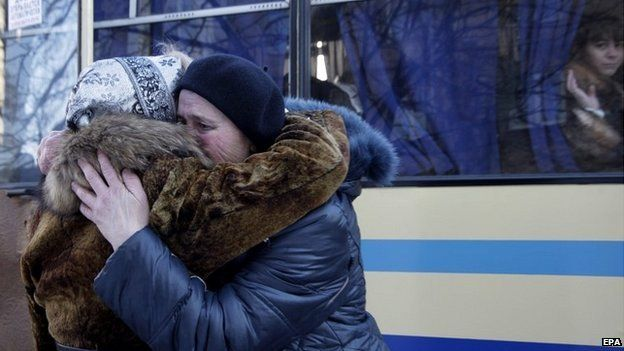 Women hug each other as they wait to evacuate to Russia from Donetsk, Ukraine - 13 February 2015