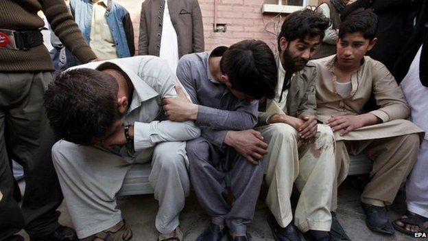 Unidentified relatives of the victims of the suicide bomb attack on a Shiite Mosque, react to the deaths of their loved ones, at a local hospital in Peshawar, Pakistan, 13 February 2015