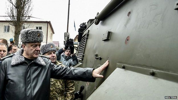 Ukrainian President Petro Poroshenko inspects an armoured personnel carrier during a visit to a military training base outside Kiev - 13 February 2015
