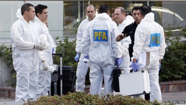 A team of police investigators arrive at Le Parc Tower where the late prosecutor Alberto Nisman was found dead