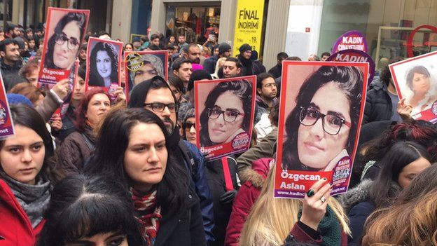 Women hold pictures of murder victim Ozgecan Aslan during protests in Istanbul on Saturday