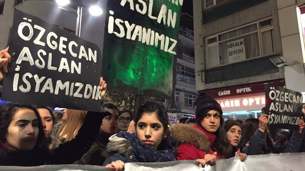 "Women hold banners reading ""Ozgecan Aslan is our rebellion"" during protests against her murder in Istanbul on Saturday night"