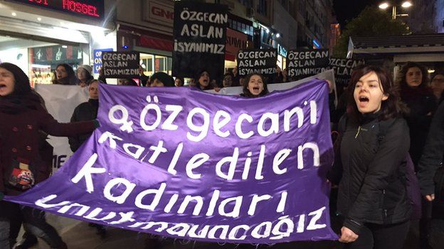 "Women hold banners - some reading ""Ozgecan Aslan is our rebellion"" - during protests in Istanbul on Saturday night"