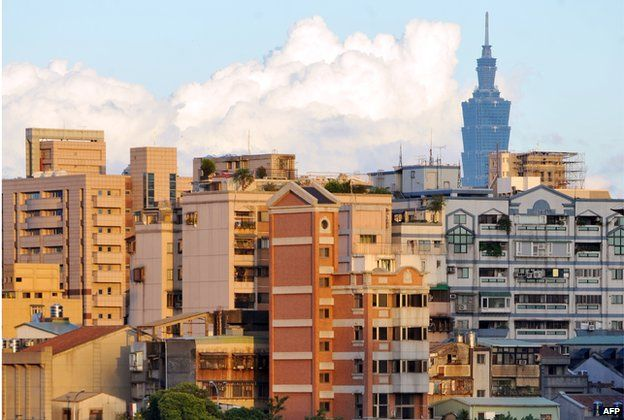 This photo taken on 18 August 2012 shows various buildings in Taipei, with the Taipei 101 building rising in the distance