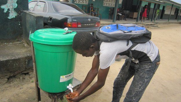 A pupil washes his hands at a school in Monrovia, Liberia on 16 February 2015