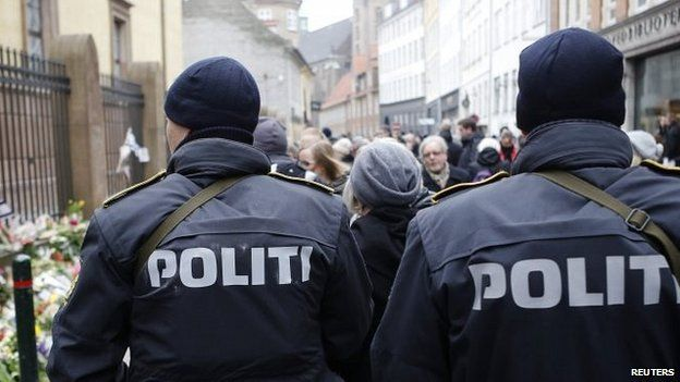 Police patrol near memorial site for victims in front of Copenhagen synagogue