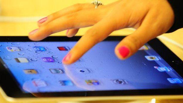 Hand with ipad