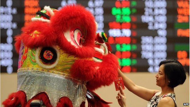 Lion dancer at Philippines stock exchange in Manila (18 Feb 2015)