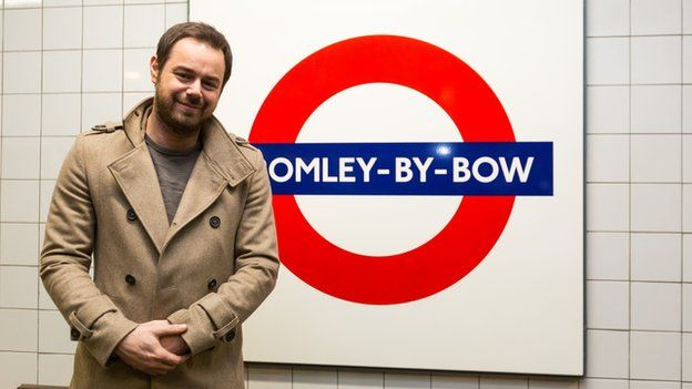Danny Dyer by a Bromley-by-Bow sign