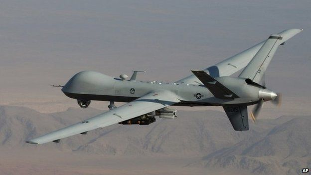 In this undated handout file photo provided by the U.S. Air Force, a MQ-9 Reaper, armed with GBU-12 Paveway II laser guided munitions and AGM-114 Hellfire missiles, is piloted by Col. Lex Turner during a combat mission over southern Afghanistan.