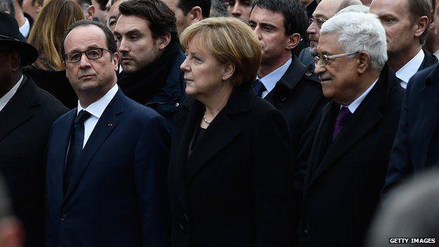Francois Hollande, Angela Merkel and Mahmoud Abbas walk during a mass unity rally following the recent terrorist attacks on January 11, 2015 in Paris, France.