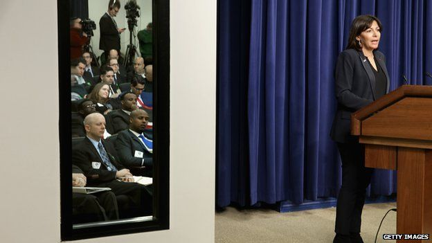 With meeting participants reflected in a mirror, Paris Mayor Anne Hidalgo (R) delivers remarks during the White House Summit on Countering Violent Extremism