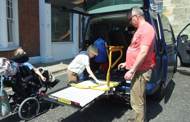 Alfie getting into his wheelchair accessible vehicle