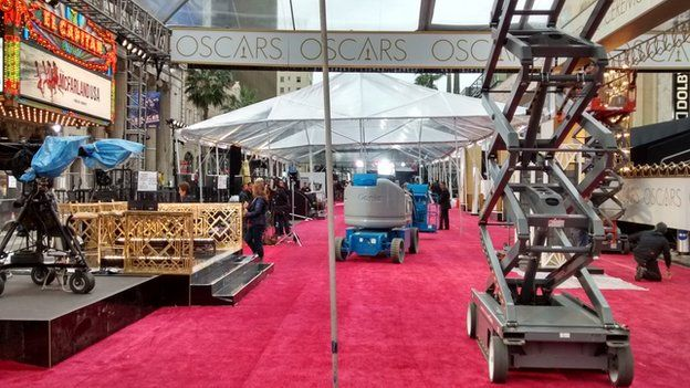 The Oscars red carpet - seen a day before the event with staff putting the surrounding structures together